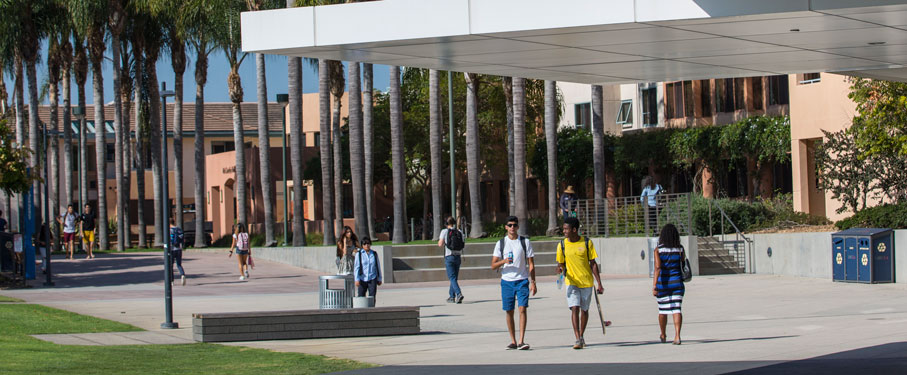 Students walking around the LMU campus near the Hannon library