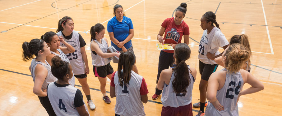 intramural women's sports team gathered together in the brc courts