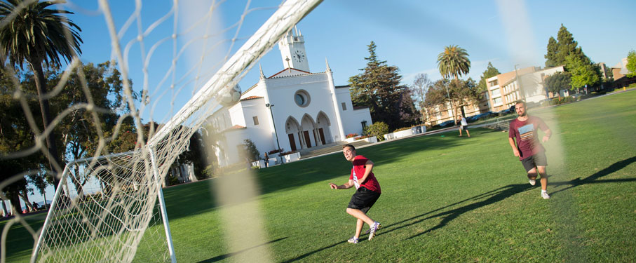 fish lens image of the soccer net featuring two lmu students
