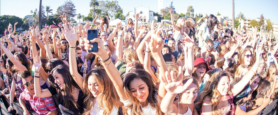 Students holding their hands up at a concert outside on LMU campus