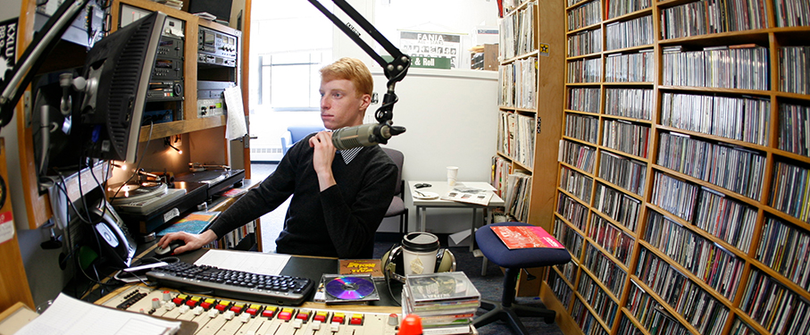 Student at the mic in the KXLU studio