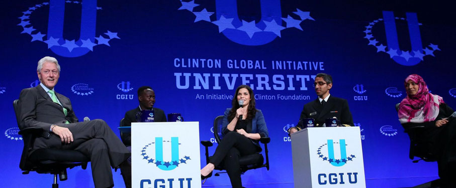 A panel of four individuals asking Bill Clinton questions at the Clinton Global Initiative.