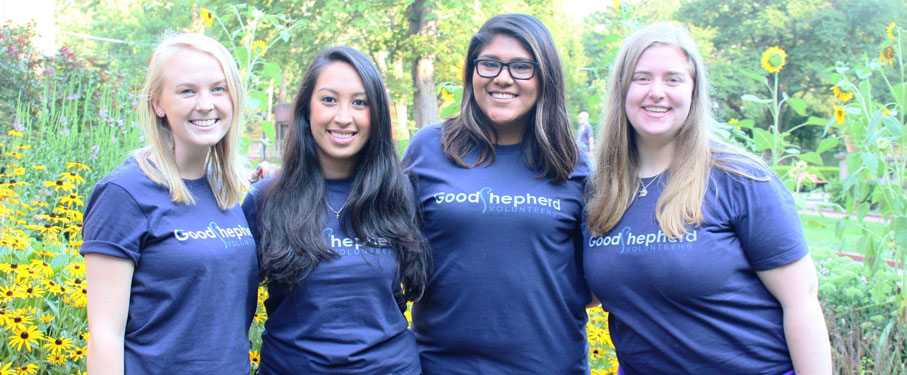 A picture of four volunteers wearing Good Shepherd shirts