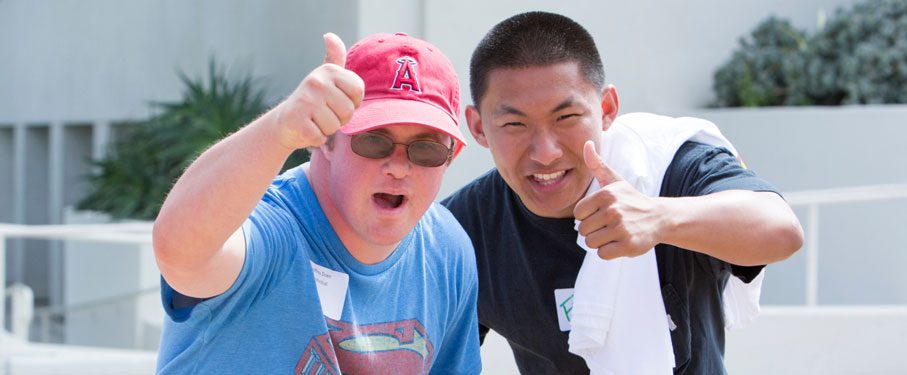 a special games volunteer and participant giving a thumbs up to the camera