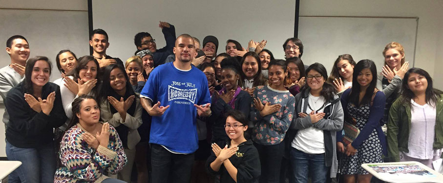 A group of LMU students posing with a member of Homeboy Industries.