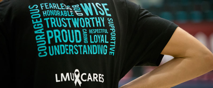 The back of a black LMU CARES shirts with a design full of empowering words.