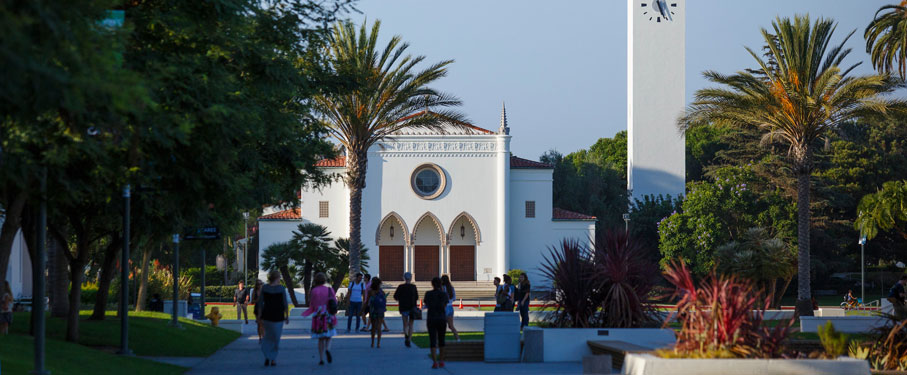 Students walking in front of the Sacred Heart Chapel.
