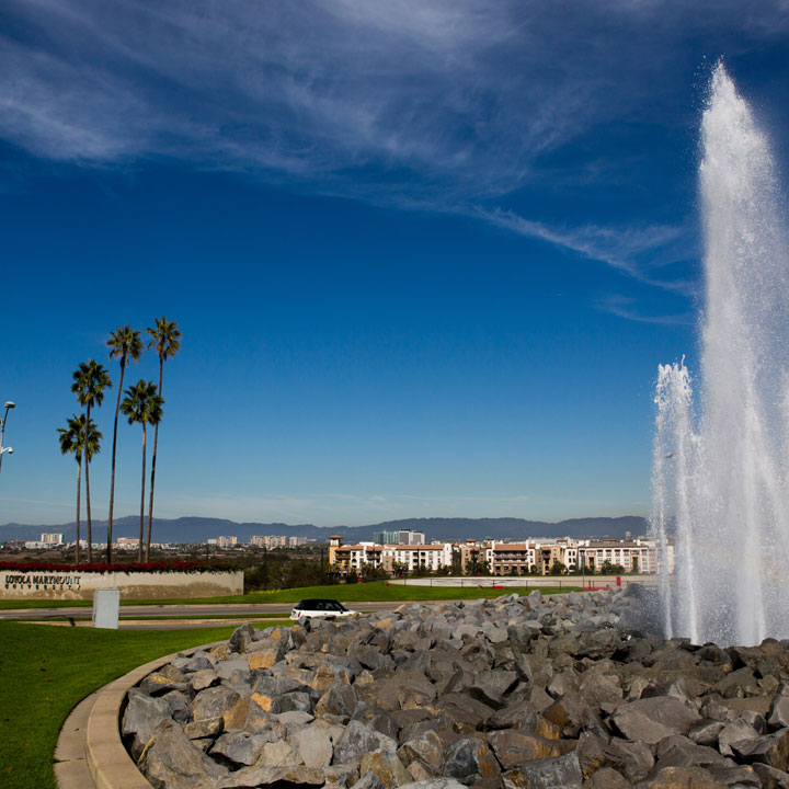 A scenic view of the water fountain in front of LMU.