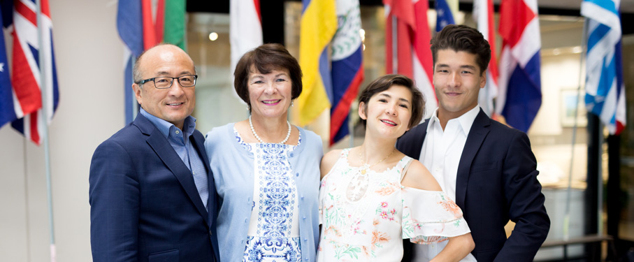 Two international students with their parents.