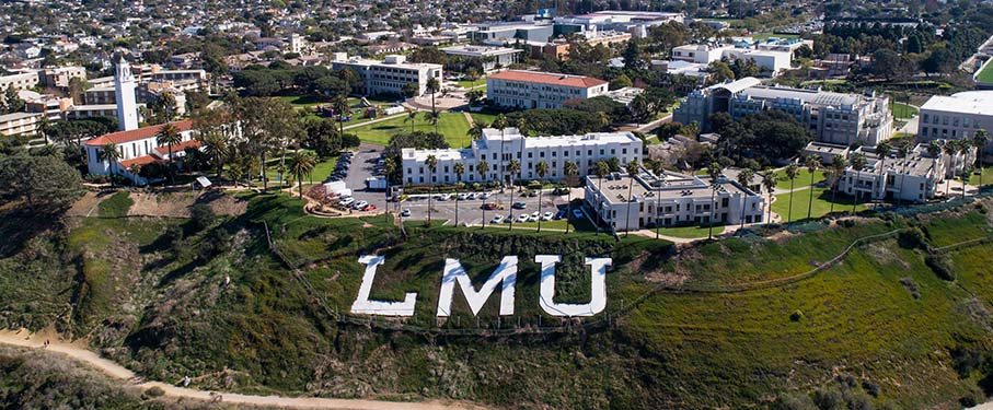 A drone shot of the LMU letters on the bluff