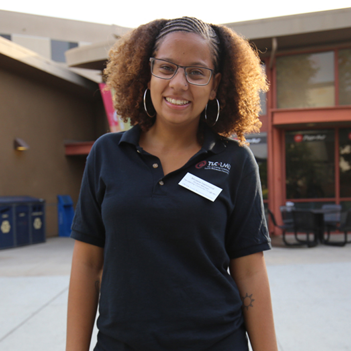 Member of LMU's TLC program, Micaela Hammond works at an event.