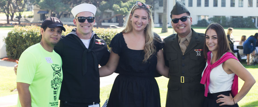 Student veterans stand outside with Veterans Program coordinator, Jamie Meugniot.